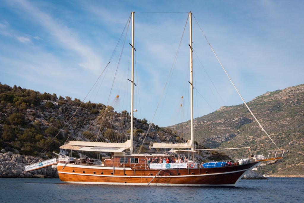 Greek Island Hopping Itinerary: Best Greek Island Hopping Routes: The Sun Fun You Yacht moored off Samiopoula islet