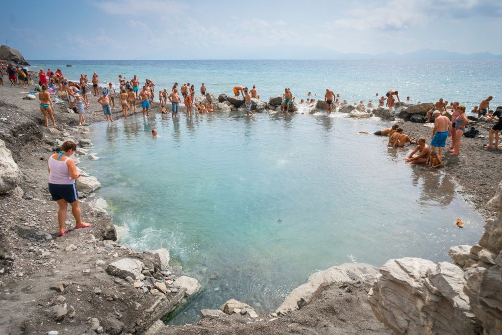 Things To Do In Kos: Soak In A Natural Coastal Hot Spring - Therma Black Sand Beach